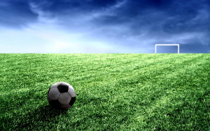 soccer pitch with ball and goalposts