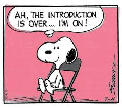 Snoopy the cartoon dog sitting in a chair
